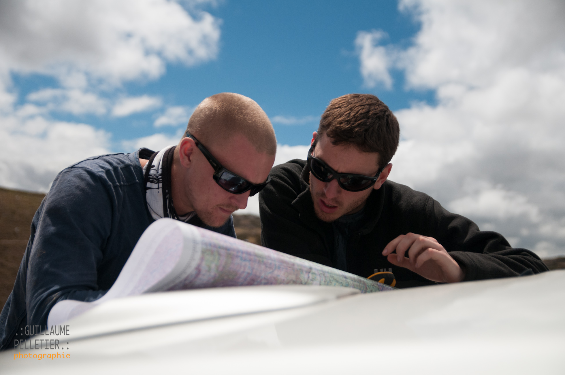 Andy and David poring over maps. Photo Guillaume Pelletier